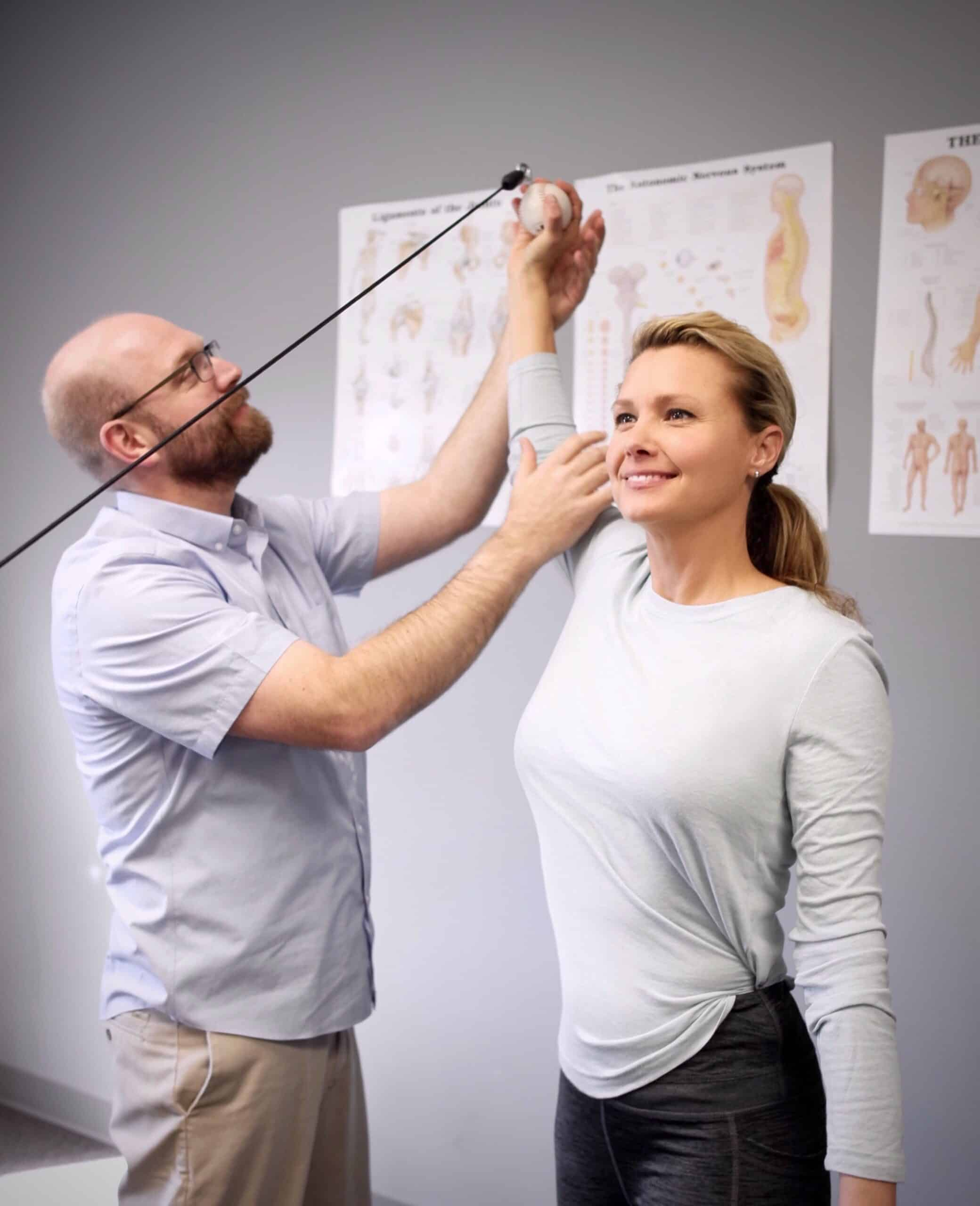 Using medical exercise therapy to help promote proper mechanics of the shoulder.