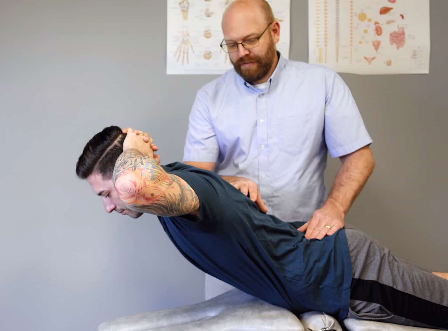 Physical-Therapist-Assessing-Back-Pain